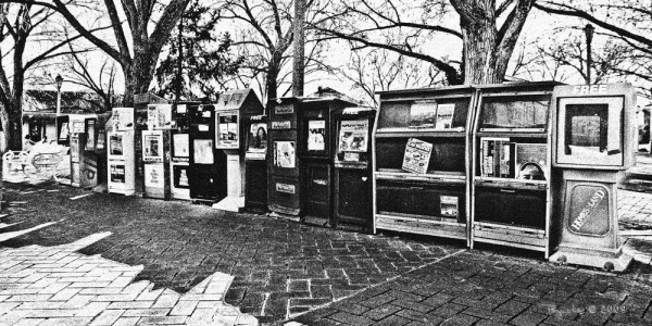 All the News that's Fit to Print. this string of newspaper boxes was found on the Square in Santa Fe, New Mexico in 2006 while I was on a solo photo trip.