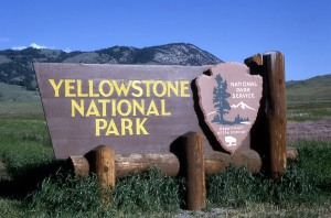 """Large wooden """"Yellowstone National Park"""" sign at the North Entrance; RG Johnsson; 1963"""