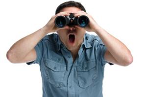 man-looking-through-binoculars