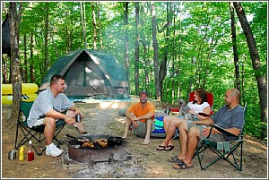 friends cooking campsite