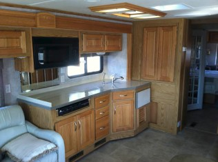 kitchen with 3 burner propane stove and '15 Sharp Microwave/Convenction oven