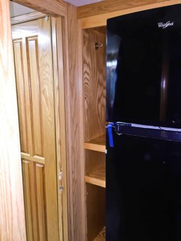 household style Whirlpool refrigerator with side storage pantry