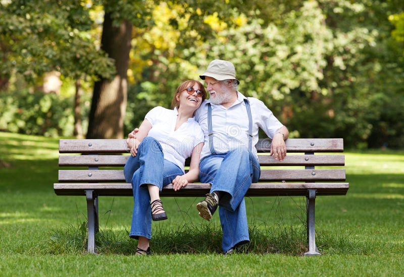 senior-couple-sitting-park-bench